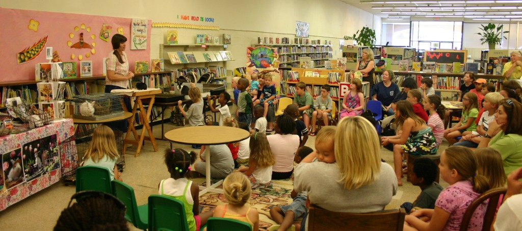 Clinton's library has story time with Garden Gate rabbits!